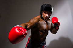 Close-up portrait of young man with boxing helmet Royalty Free Stock Images