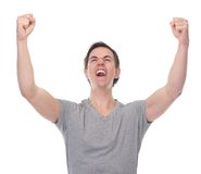 Close up portrait of a young man celebrating with open arms. Isolated on white Royalty Free Stock Images