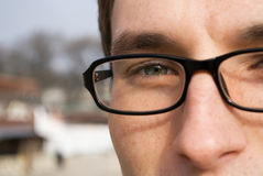 Close-up portrait of young man in glasses - detail Royalty Free Stock Image