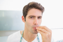 Close up portrait of a young man kissing fingers Stock Photos