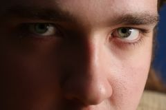 Close-up portrait of a young man looking at the camera Royalty Free Stock Photography