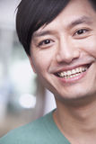 Close up portrait of young man smiling, Beijing Royalty Free Stock Images