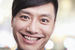 Close up portrait of young man smiling and looking into camera, Beijing Royalty Free Stock Photography