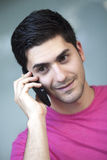 Close up portrait of young man talking on phone Royalty Free Stock Images