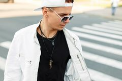 Close up portrait of a young man in a white jacket royalty free stock photo