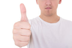 Close up portrait of young man in white  t-shirt thumbs up Royalty Free Stock Photo