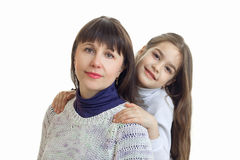 A close-up portrait of a young mother with a cute little girl Royalty Free Stock Photo