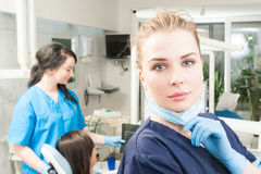 Close-up portrait of young orthodontist in dental clinic. Wearing uniform and gloves Stock Photography