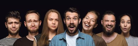 Close up portrait of young people isolated on black studio background stock photography