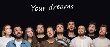 Close up portrait of young people isolated on black studio background royalty free stock images