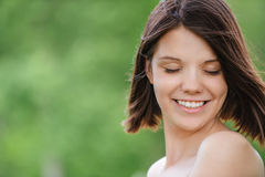 Close-up portrait of young pleasant dark-haired woman Stock Photography