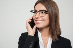Close up portrait of a young pleased businesswoman Stock Images