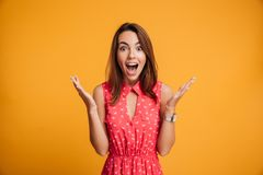 Close-up portrait of young pretty surprised woman with opened mo Royalty Free Stock Photography