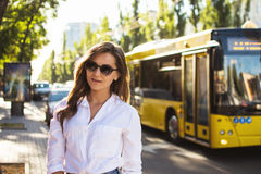 Close-up portrait of young pretty trendy girl posing at the city in Europe,summer street fashion. royalty free stock image