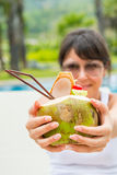 Close-up portrait young pretty woman drinking coconut cocktail Stock Photography