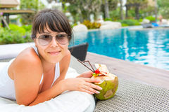 Close-up portrait young pretty woman drinking coconut cocktail Royalty Free Stock Photography