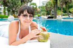 Close-up portrait young pretty woman drinking coconut cocktail Royalty Free Stock Photos