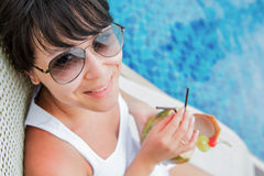 Close-up portrait young pretty woman drinking coconut cocktail Stock Image