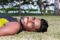 Close up portrait of young smiling asian indian yoga man outside. Park, beachside. Bali island. Stock Images