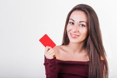 Close-up portrait of young smiling business woman holding credit card royalty free stock image