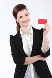 Close-up portrait of young smiling business woman holding credit. Card isolated on white background Royalty Free Stock Photo