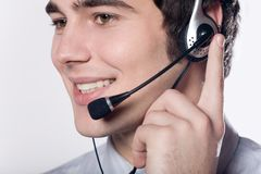 Close-up portrait of young smiling businessman with headset Stock Photo