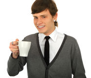 Close-up portrait of young smiling man with a cup. Isolated background Royalty Free Stock Photos