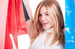 Close-up portrait of young smiling woman with shopping bags Stock Photography