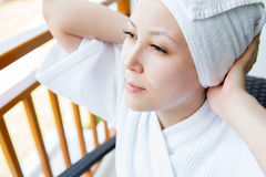 Close-up portrait of young smiling woman with towel hat , at hom Royalty Free Stock Photo