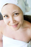 Close-up portrait of young smiling woman with towel hat , at hom Royalty Free Stock Photos