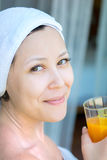 Close up portrait of young smiling woman with a towel hat Royalty Free Stock Image