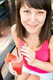 Close  up portrait of young smiling woman with the watermelon ju Stock Image