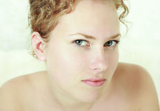 Close-up portrait of young woman. Close-up portrait of caucasian young woman with beautiful green eyes stock photo