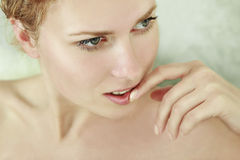 Close-up portrait of young woman. Close-up portrait of caucasian young woman with beautiful green eyes stock images