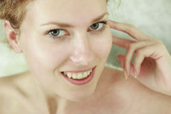 Close-up portrait of young woman. Close-up portrait of caucasian smiling young woman with beautiful green eyes royalty free stock image