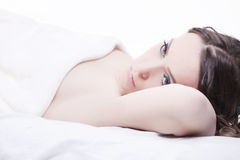 Close-up portrait of a young woman. Lying in bed stock images