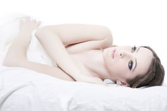 Close-up portrait of a young woman. Lying in bed Royalty Free Stock Image