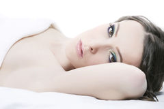 Close-up portrait of a young woman. Lying in bed royalty free stock photography
