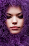Close-up portrait of young woman. In violet fur Stock Photo