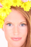 Close up portrait of a young woman. Woman face with flowers in studio Royalty Free Stock Photos