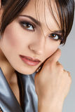 Close-up portrait of young woman. Close-up portrait of young brunette woman touching cheek Stock Photography