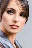 Close-up portrait of young woman. Close-up portrait of young brunette woman looking away Stock Photo