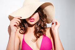 Close-up portrait of a young woman in beach hat Stock Photo
