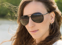 Close up portrait of young woman in black glasses. Royalty Free Stock Photography
