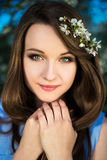Close up portrait of young woman with blooming cherry branch in Stock Photo