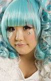 Close-up portrait of young woman with blue hair dressed as a doll Royalty Free Stock Photos