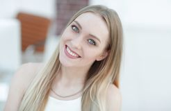 Close-up portrait of a young woman on a blurred office background. Stock Image