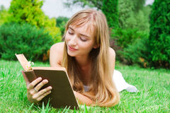 Close-up portrait of a young woman with a  book Royalty Free Stock Image