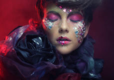 Close up portrait young woman with bright fantasy make up Stock Image