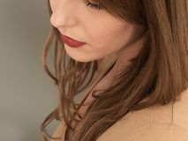 Close Up Portrait Of A Young Woman Deep In Thought. Daydreaming Shot From A High Angle And In A Tight Crop Stock Image